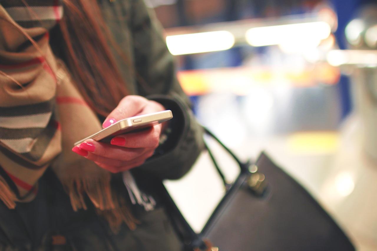 Woman checking mobile